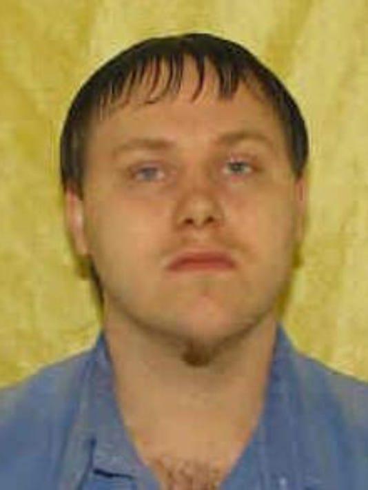 Capture Nathan Graham prison mug.JPG