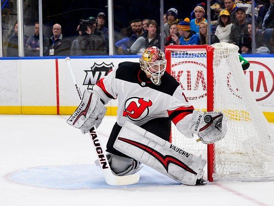 New Jersey Devils goaltender Keith Kinkaid (1) defends