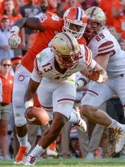 Clemson defensive end Clelin Ferrell (99), left, is