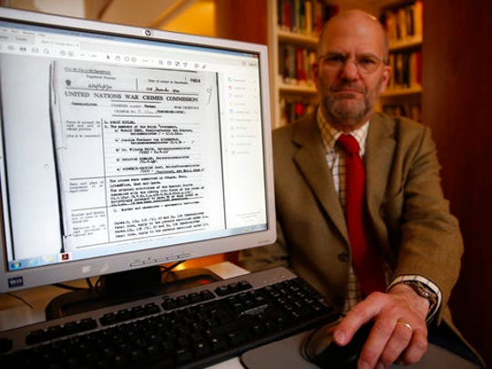 Ben Barkow, Director of the Wiener Library for the Study of Holocaust & Genocide displays a United Nations' file from the Czechoslovak government in exile making its case for war crimes against Adolf Hitler, in London, Friday, April 21, 2017. The library is making the United Nations' files on World War II war crimes more accessible by allowing the general public to search an online catalog of the documents for the first time beginning Friday. People will still have to visit the library in London or the U.S. Holocaust Museum to read the actual files.