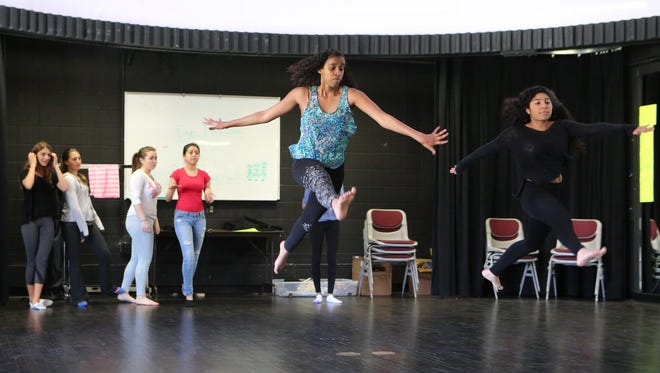Dagmawit Dawit and Amy Ferreira perform some exercises in Deborah Toteda's Dance Studio One class at Harrison High School.