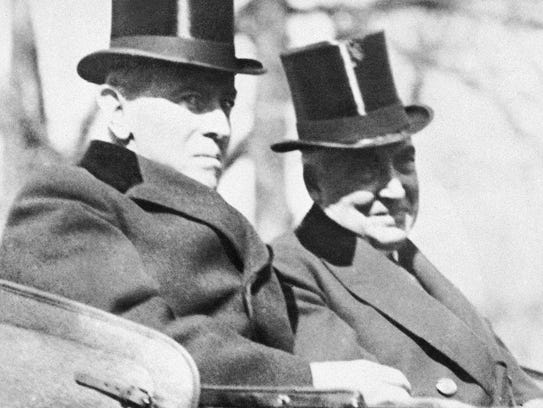 The retiring 28th President Woodrow Wilson, rides with