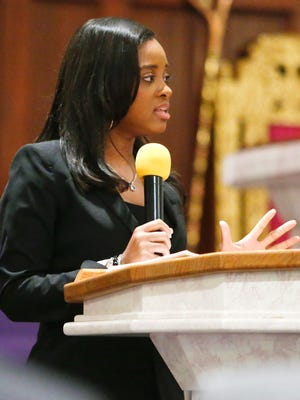 Keynote speaker Tamika Mallory delivers remarks during a forum on race and justice held at the Tabernacle Full Gospel Baptist Cathedral in Wilmington Tuesday.
