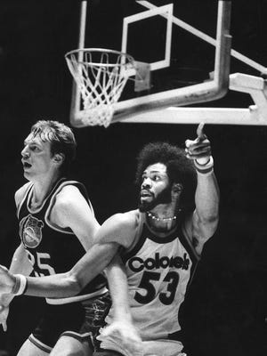 Dan Issel, of Denver, tries to defend against Artis Gilmore in their first game against one another since Issel was traded in the 1975 off-season.