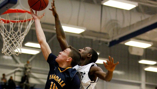 Fairdale's Caleb Longacre, #10, tries to get a shot past PRP's Jamaine Archie, #22, during their game in the LIT at Valley High School. Jan. 14, 2014