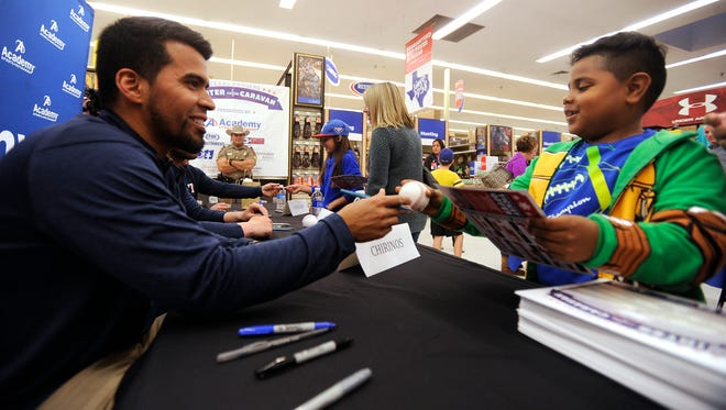 Seven-year-old Knoah Turner, from Hawley, gets his baseball signed by Texas Rangers catcher Robinson Chirinos during the Ranger's Winter Caravan stop in Abilene on Friday, Feb. 3, 2017, at Academy Sports + Outdoors.