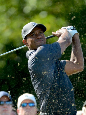 Tiger Woods hits his tee shot on the 16th hole during