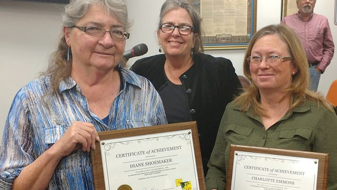 Lincoln County Clerk Rhonda Burrows thanked staff members Diane Shoemaker and Charlotte Emmons for the hours and years of work they squeezed into their regular assignments to accomplish the job. From left are Shoemaker, Burrows and Emmons.