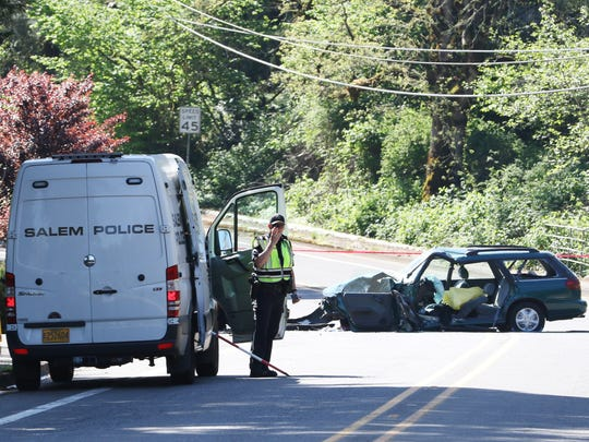 Salem Police investigate a crash on Sunnyside near Pawnee Cr SE on Tuesday, April 19, 2016.
