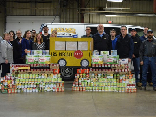The Leonard Bus Sales stands alongside food collected