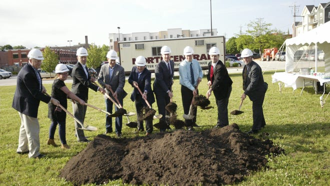 Officials break ground on the Encore Apartments Thursday night.