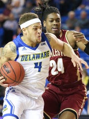 Delaware's Darian Bryant drives against the College of Charleston's Jaylen McManus in the first half at the Bob Carpenter Center Thursday.