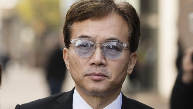 """Sun Peng walks from the federal courthouse in Philadelphia, Monday, Nov. 19, 2018. his son An-Tso Sun, a Taiwanese exchange student accused of threatening to """"shoot up"""" his high school near Philadelphia has been spared additional time in prison but will be deported. (AP Photo/Matt Rourke)"""