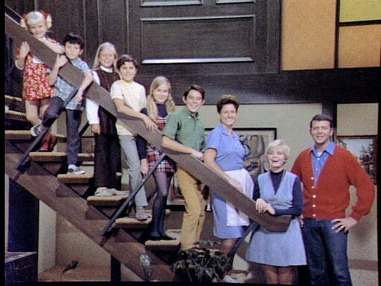 Ann B. Davis (third from right) who played Alice on The Brady Bunch.'