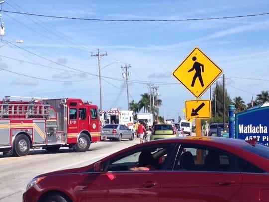 Emergency crews respond to a crash involving a pedestrian on Pine Island Road and Island Avenue Tuesday, Jan. 6, 2015