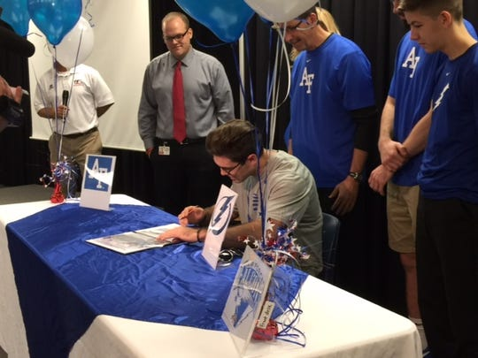 Carson Pearlman signs his national letter of intent to join the United States Air Force Academy on Wednesday
