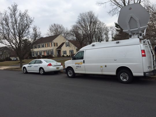 News12 New Jersey vehicles parked on Friday outside the former residence of John and Joyce Sheridan at 49 Meadow Run Drive in the Skillman section of Montgomery.
