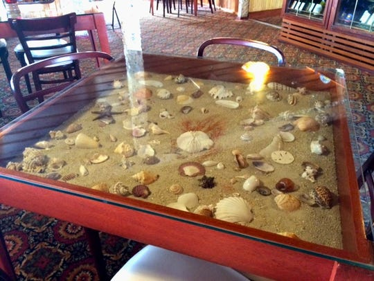 The fun tabletops at Kelly's Fish House in Naples.
