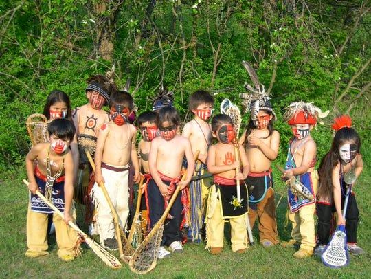 A photograph taken in 2004 shows a dozen kids ages