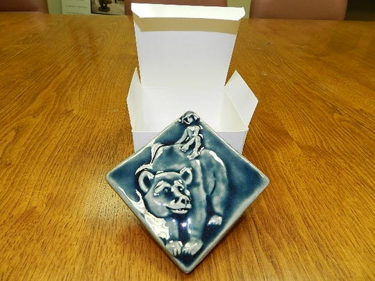 "Pewabic tile of ""Boy and Bear"""