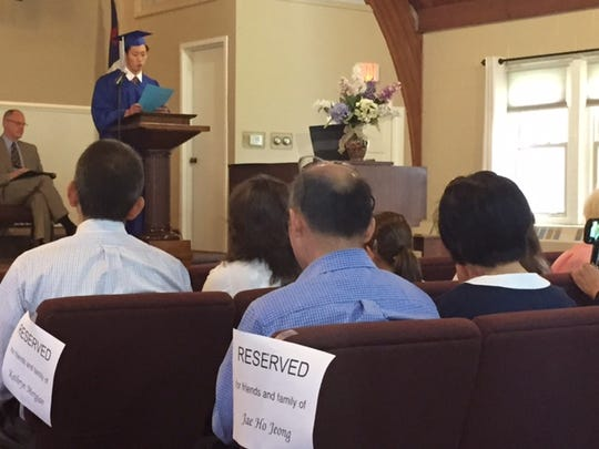 Valedictorian Jae Ho Jeong of South Korea delivers his address Saturday at the Tabernacle Christian Academy graduation.