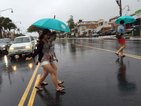 Heavy rain from Tropical Storm Chan-hom caused flooding around Tumon on Sunday, January 5, 2015.
