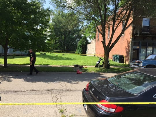 City police at the scene of a shooting Tuesday morning in the 1100 block of East Adams Street