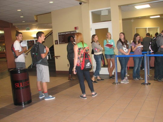 Students going through orientation Tuesday wait in line at the Financial Aid window at Southern Utah University. They will all be participating in a series of events called Thunder Academy beginning Thursday.