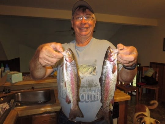 David Langton with two rainbow trout he caught from