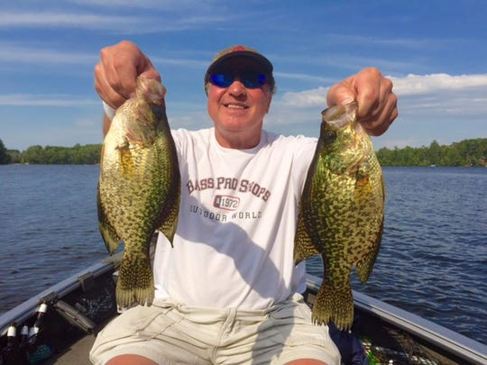 Dale Evans with a pair of beautiful crappies caught