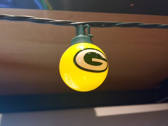 Team Tailgate String Lights  Fifteen alternating green and gold bulbs stamped with the Packers logo to help lend a festive atmosphere wherever the game-day party may be. And we're pretty sure there's nothing in the Packers fan rulebook that says you couldn't string them up on the fireplace over the green-and-gold stockings for Christmas, too. $32.95 at Packers Pro Shop in Lambeau Field