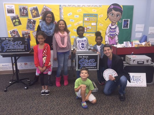 Magician Chad Juros and some of the children who enjoyed