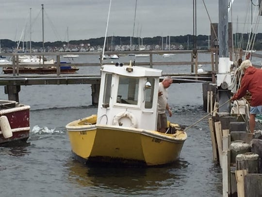 Frank Wild prepares to move his boat out of the water