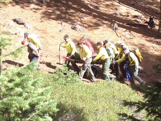 Washoe County search and rescue teams carry a missing, elderly California man they found on Monday in the wilderness in Incline Village.