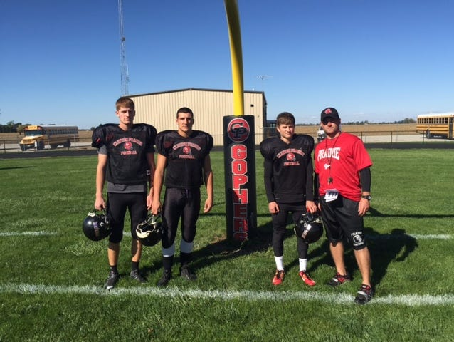 Quarterback Chase Joseph, running back Sam Schoonveld, safety Kristian Peters, coach K.C. Woods.