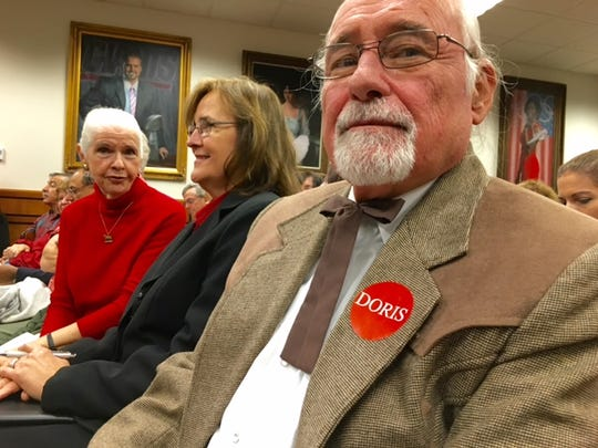 Carl Suk, who was born and raised on Duke Farms and now lives in Kentucky, spoke against the demolition plan on Thursday. He is wearing a sticker for opposition group DORIS, Demolition of Residence Is Senseless.