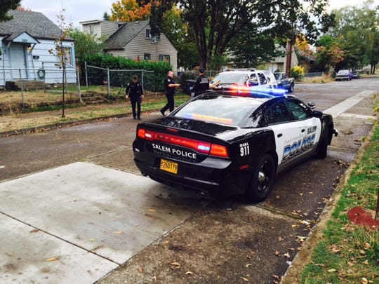Police gather at the scene of an incident on 15th Street and Hines Street SE after a man reportedly choked a police dog unconscious on Saturday, Oct. 17, 2015.