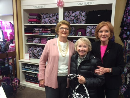 Joan Bradley Reedy, left, and Barbara Bradley Baekgaard, right, pose with Barbara Nordstrom of Egg Harbor, who came to visit the sisters at the breast cancer fundraiser Saturday hosted by Wilkins & Olander.