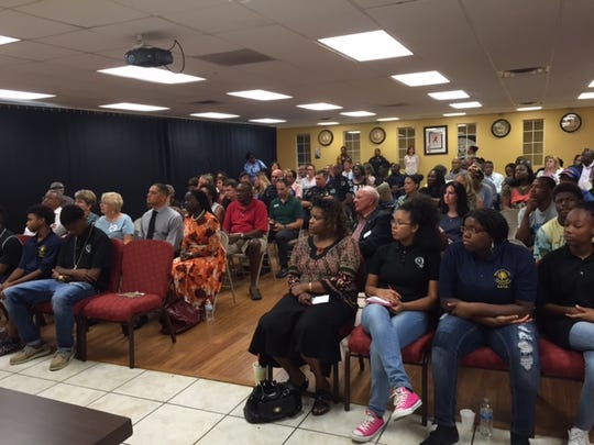 Over 70 people listen to various speakers during the