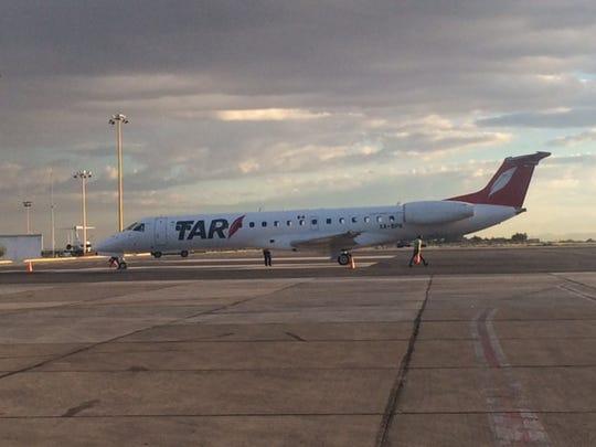 TAR Aerolineas' ERJ-145 jet arrives Thursday at the Abraham González International Airport in south Juárez