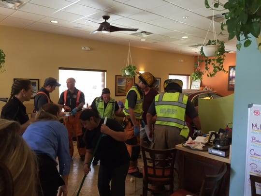 Emergency workers attend to patrons hurt when a car crashed through the doors of Old 41 Restaurant in Bonita Sprngs on Sunday.