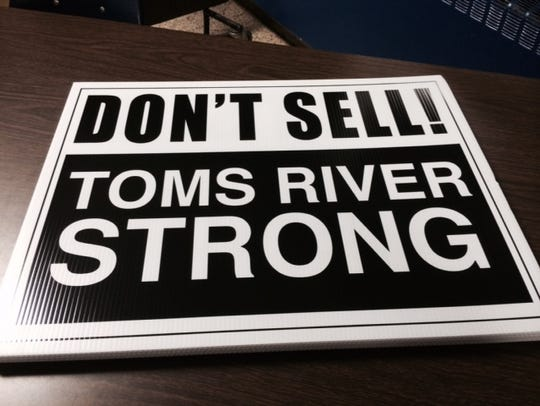 Signs that were distributed Monday night at a meeting