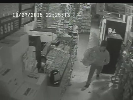 A burglar crossed the counter of a Waterford Township gas station six times as he collected cigarettes to steal at about 11:30 p.m. Tuesday, Oct. 27, 2015. Police seek anyone with information on the incident.