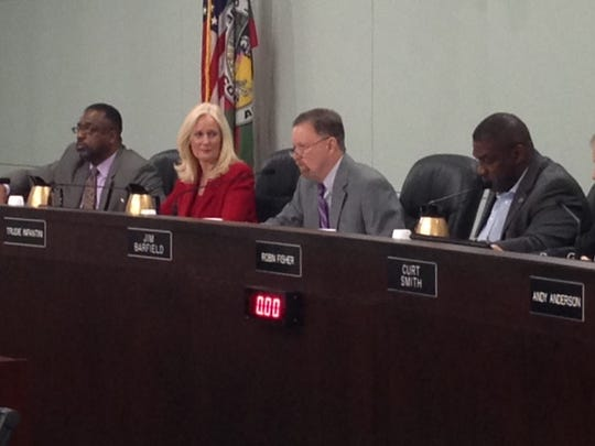 County commissioners discuss a proposed increase in the gas tax.