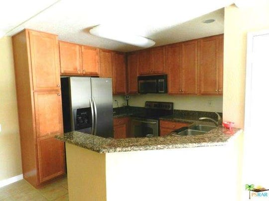 A view of the pentagon-shaped kitchen in a one-bed, one-bath Bermuda Dunes condo.
