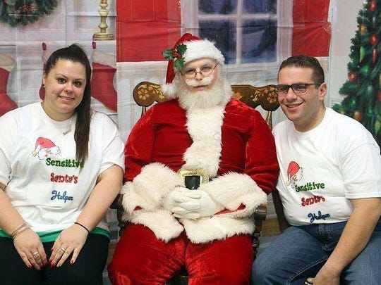The sixth annual Angelina Paglia's Memorial Sensitive Santa for Children with Autism will be conducted from 9 a.m. to 6:30 p.m. Saturday, Dec. 12, at the Helmetta Fire Department, 62 Main St., Helmetta. Pictured at the 2014 event  is left to right event founder Gerriann LaGuardia, Sensitive Santa Rob Simonelli  Jr., and event assistant Robert Meloro.