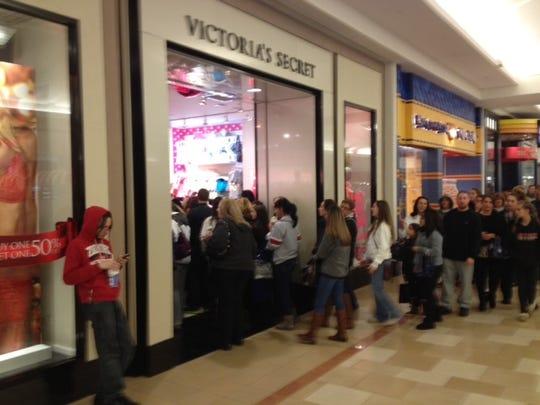 Crowds line up to enter the Victoria's Secret store