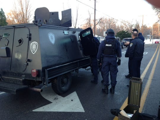 Police brought in an armored vehicle as they dealt with a burglar trapped in a house on West Minges Road on Wednesday morning.
