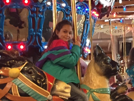 Jasmine Byler of Fredericksburg, Ohio was the 4,000,000th rider at the Richland Carrousel Park on Friday.