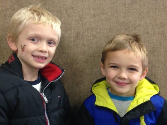 Jordan Smith, 8, left, and Owen Smith, 6, of Farmington.